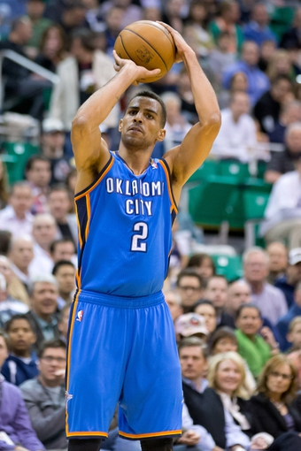 Apr 9, 2013; Salt Lake City, UT, USA; Oklahoma City Thunder shooting guard Thabo Sefolosha (2) shoots during the first quarter against the Utah Jazz at EnergySolutions Arena. Mandatory Credit: Russ Isabella-USA TODAY Sports