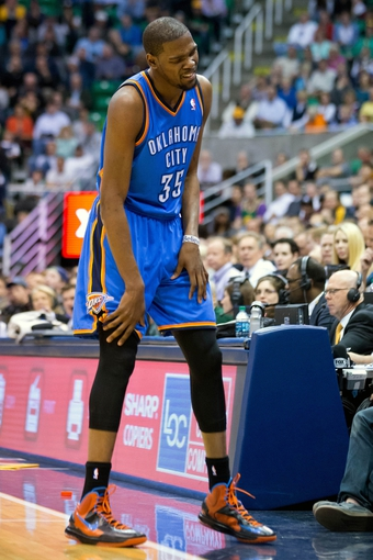 Apr 9, 2013; Salt Lake City, UT, USA; Oklahoma City Thunder small forward Kevin Durant (35) reacts to injuring his leg during the first quarter against the Utah Jazz at EnergySolutions Arena. Mandatory Credit: Russ Isabella-USA TODAY Sports