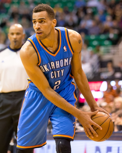Apr 9, 2013; Salt Lake City, UT, USA; Oklahoma City Thunder shooting guard Thabo Sefolosha (2) controls the ball during the first half against the Utah Jazz at EnergySolutions Arena. Mandatory Credit: Russ Isabella-USA TODAY Sports