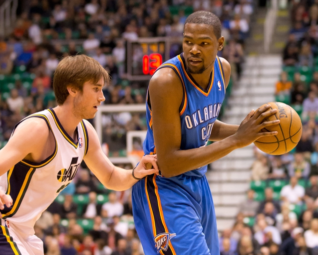 Apr 9, 2013; Salt Lake City, UT, USA; Oklahoma City Thunder small forward Kevin Durant (35) is defended by Utah Jazz shooting guard Gordon Hayward (20) during the first half at EnergySolutions Arena. Mandatory Credit: Russ Isabella-USA TODAY Sports