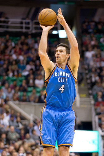 Apr 9, 2013; Salt Lake City, UT, USA; Oklahoma City Thunder power forward Nick Collison (4) shoots during the first half against the Utah Jazz at EnergySolutions Arena. Mandatory Credit: Russ Isabella-USA TODAY Sports