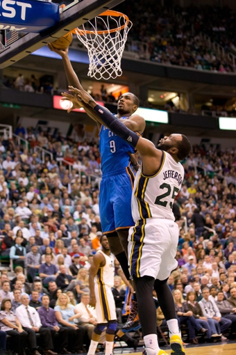 Apr 9, 2013; Salt Lake City, UT, USA; Oklahoma City Thunder power forward Serge Ibaka (9) goes up for a shot while defended by Utah Jazz center Al Jefferson (25) during the first half at EnergySolutions Arena. Mandatory Credit: Russ Isabella-USA TODAY Sports