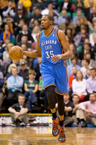 Apr 9, 2013; Salt Lake City, UT, USA; Oklahoma City Thunder small forward Kevin Durant (35) dribbles up court during the first half against the Utah Jazz at EnergySolutions Arena. Mandatory Credit: Russ Isabella-USA TODAY Sports