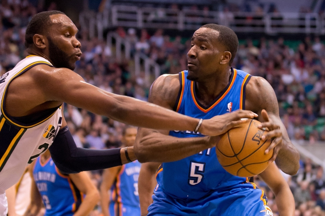 Apr 9, 2013; Salt Lake City, UT, USA; Utah Jazz center Al Jefferson (25) knocks the ball away from Oklahoma City Thunder center Kendrick Perkins (5) during the first half at EnergySolutions Arena. Mandatory Credit: Russ Isabella-USA TODAY Sports