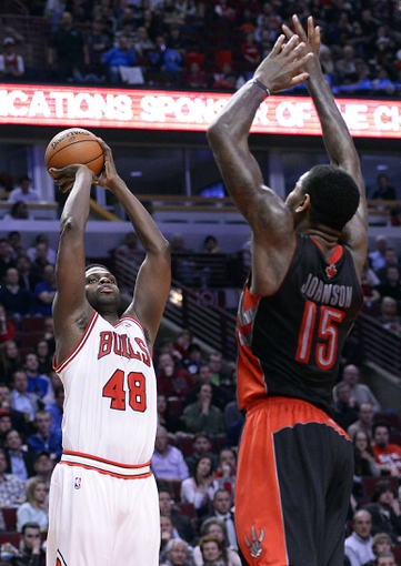 Apr 9, 2013; Chicago, IL, USA; Chicago Bulls center Nazr Mohammed (48) shoots the ball against Toronto Raptors power forward Amir Johnson (15) during the second half at the United Center. Toronto defeats Chicago 101-98. Mandatory Credit: Mike DiNovo-USA TODAY Sports