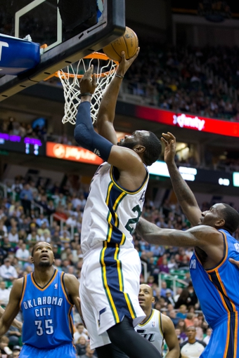 Apr 9, 2013; Salt Lake City, UT, USA; Utah Jazz center Al Jefferson (25) goes to the basket over Oklahoma City Thunder small forward Kevin Durant (35) and center Kendrick Perkins (5) during the second half at EnergySolutions Arena. The Thunder won 90-80. Mandatory Credit: Russ Isabella-USA TODAY Sports