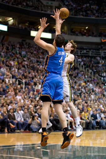 Apr 9, 2013; Salt Lake City, UT, USA; Utah Jazz shooting guard Gordon Hayward (20) attempts to shoot over Oklahoma City Thunder power forward Nick Collison (4) during the second half at EnergySolutions Arena. The Thunder won 90-80. Mandatory Credit: Russ Isabella-USA TODAY Sports