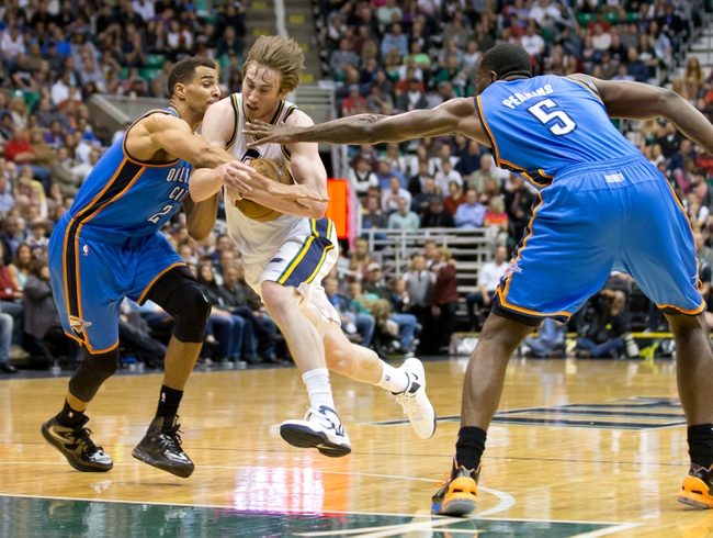 Apr 9, 2013; Salt Lake City, UT, USA; Utah Jazz shooting guard Gordon Hayward (20) attempts to split the defense of Oklahoma City Thunder shooting guard Thabo Sefolosha (2) and center Kendrick Perkins (5) during the second half at EnergySolutions Arena. The Thunder won 90-80. Mandatory Credit: Russ Isabella-USA TODAY Sports