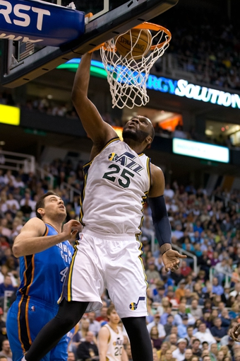 Apr 9, 2013; Salt Lake City, UT, USA; Utah Jazz center Al Jefferson (25) dunks over Oklahoma City Thunder power forward Nick Collison (4) during the second half at EnergySolutions Arena. The Thunder won 90-80. Mandatory Credit: Russ Isabella-USA TODAY Sports