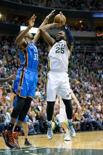 Apr 9, 2013; Salt Lake City, UT, USA; Utah Jazz center Al Jefferson (25) shoots while defended by Oklahoma City Thunder small forward Kevin Durant (35) during the second half at EnergySolutions Arena. The Thunder won 90-80. Mandatory Credit: Russ Isabella-USA TODAY Sports
