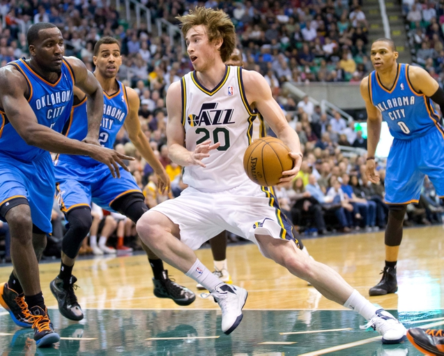 Apr 9, 2013; Salt Lake City, UT, USA; Utah Jazz shooting guard Gordon Hayward (20) controls the ball while surrounded by Oklahoma City Thunder center Kendrick Perkins (5) and teammates shooting guard Thabo Sefolosha (2) and point guard Russell Westbrook (0) during the second half at EnergySolutions Arena. The Thunder won 90-80. Mandatory Credit: Russ Isabella-USA TODAY Sports