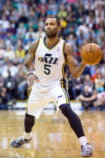 Apr 9, 2013; Salt Lake City, UT, USA; Utah Jazz point guard Mo Williams (5) passes the ball during the second half against the Oklahoma City Thunder at EnergySolutions Arena. The Thunder won 90-80. Mandatory Credit: Russ Isabella-USA TODAY Sports