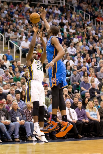 Apr 9, 2013; Salt Lake City, UT, USA; Utah Jazz power forward Paul Millsap (24) shoots over Oklahoma City Thunder small forward Kevin Durant (35) during the second half at EnergySolutions Arena. The Thunder won 90-80. Mandatory Credit: Russ Isabella-USA TODAY Sports