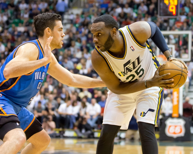 Apr 9, 2013; Salt Lake City, UT, USA; Utah Jazz center Al Jefferson (25) is defended by Oklahoma City Thunder power forward Nick Collison (4) during the second half at EnergySolutions Arena. The Thunder won 90-80. Mandatory Credit: Russ Isabella-USA TODAY Sports