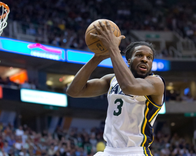 Apr 9, 2013; Salt Lake City, UT, USA; Utah Jazz small forward DeMarre Carroll (3) grabs a rebound during the second half against the Oklahoma City Thunder at EnergySolutions Arena. The Thunder won 90-80. Mandatory Credit: Russ Isabella-USA TODAY Sports