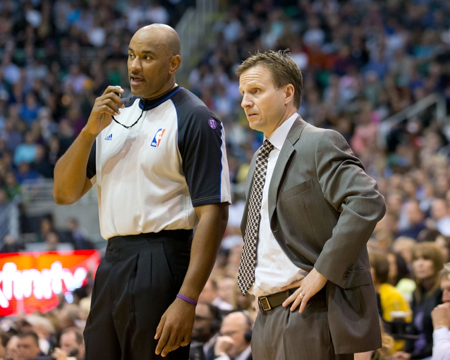 Apr 9, 2013; Salt Lake City, UT, USA; Oklahoma City Thunder head coach Scott Brooks talks with referee Kevin Cutler (34) during the second half against the Utah Jazz at EnergySolutions Arena. The Thunder won 90-80. Mandatory Credit: Russ Isabella-USA TODAY Sports