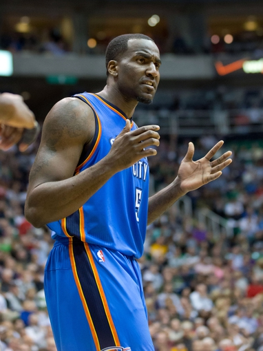 Apr 9, 2013; Salt Lake City, UT, USA; Oklahoma City Thunder center Kendrick Perkins (5) reacts to a call during the second half against the Utah Jazz at EnergySolutions Arena. The Thunder won 90-80. Mandatory Credit: Russ Isabella-USA TODAY Sports