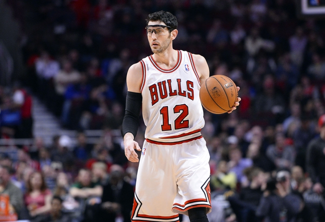 Apr 9, 2013; Chicago, IL, USA; Chicago Bulls shooting guard Kirk Hinrich (12) dribbles the ball against the Toronto Raptors during the second half at the United Center. Toronto defeats Chicago 101-98. Mandatory Credit: Mike DiNovo-USA TODAY Sports