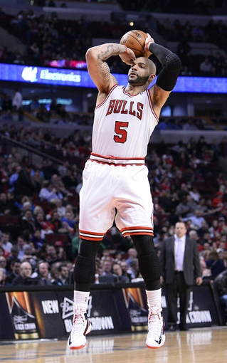 Apr 9, 2013; Chicago, IL, USA; Chicago Bulls power forward Carlos Boozer (5) shoots the ball against the Toronto Raptors during the second half at the United Center. Toronto defeats Chicago 101-98. Mandatory Credit: Mike DiNovo-USA TODAY Sports