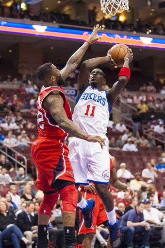 Apr 10, 2013; Philadelphia, PA, USA; Philadelphia 76ers guard Jrue Holiday (11) shoots during the first quarter against the Atlanta Hawks at the Wells Fargo Center. Mandatory Credit: Howard Smith-USA TODAY Sports
