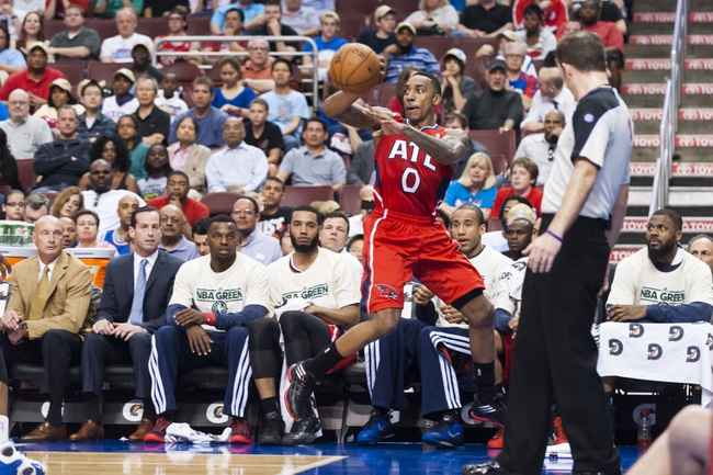 Apr 10, 2013; Philadelphia, PA, USA; Atlanta Hawks guard Jeff Teague (0) saves the ball from going out of bounds during the second quarter against the Philadelphia 76ers at the Wells Fargo Center. Mandatory Credit: Howard Smith-USA TODAY Sports