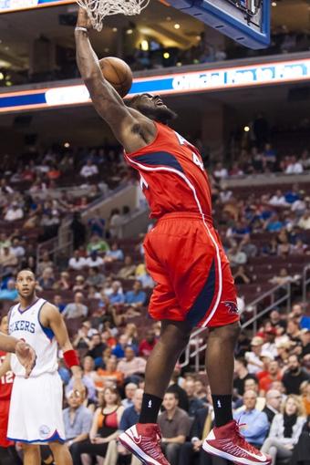 Apr 10, 2013; Philadelphia, PA, USA; Atlanta Hawks forward Ivan Johnson (44) dunks during the second quarter against the Philadelphia 76ers at the Wells Fargo Center. Mandatory Credit: Howard Smith-USA TODAY Sports