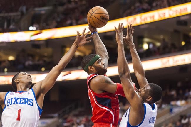 Apr 10, 2013; Philadelphia, PA, USA; Atlanta Hawks forward Josh Smith (5) shoots over the defense of Philadelphia 76ers forward Thaddeus Young (21) during the second quarter at the Wells Fargo Center. Mandatory Credit: Howard Smith-USA TODAY Sports