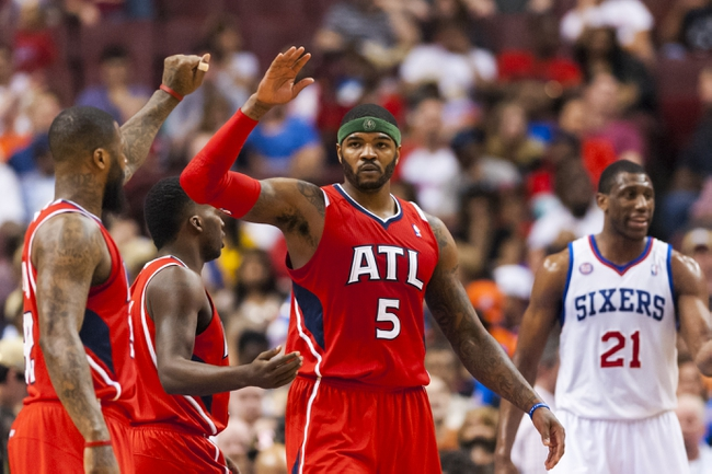 Apr 10, 2013; Philadelphia, PA, USA; Atlanta Hawks forward Josh Smith (5) celebrates with teammates during the third quarter against the Philadelphia 76ers at the Wells Fargo Center. The Hawks defeated the Sixers 124-101. Mandatory Credit: Howard Smith-USA TODAY Sports