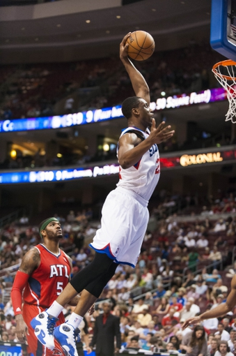 Apr 10, 2013; Philadelphia, PA, USA; Philadelphia 76ers forward Thaddeus Young (21) dunks during the third quarter against the Atlanta Hawks at the Wells Fargo Center. The Hawks defeated the Sixers 124-101. Mandatory Credit: Howard Smith-USA TODAY Sports