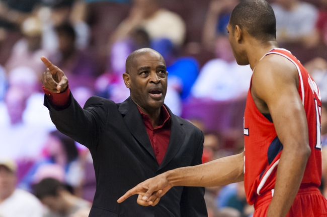 Apr 10, 2013; Philadelphia, PA, USA; Atlanta Hawks head coach Larry Drew talks with center Al Horford (15) during the third quarter against the Philadelphia 76ers at the Wells Fargo Center. The Hawks defeated the Sixers 124-101. Mandatory Credit: Howard Smith-USA TODAY Sports