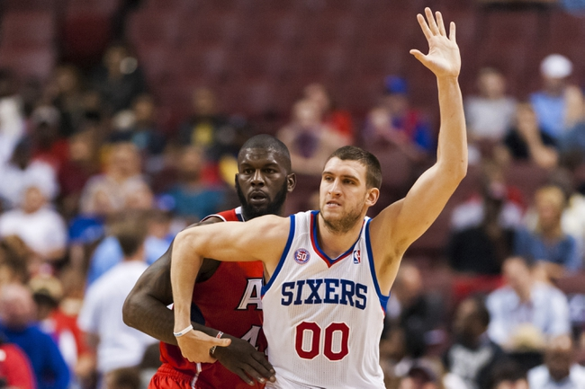 Apr 10, 2013; Philadelphia, PA, USA; Philadelphia 76ers center Spencer Hawes (00) is defended by Atlanta Hawks forward Ivan Johnson (44) during the fourth quarter at the Wells Fargo Center. The Hawks defeated the Sixers 124-101. Mandatory Credit: Howard Smith-USA TODAY Sports