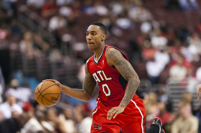 Apr 10, 2013; Philadelphia, PA, USA; Atlanta Hawks guard Jeff Teague (0) brings the ball up court during the fourth quarter against the Philadelphia 76ers at the Wells Fargo Center. The Hawks defeated the Sixers 124-101. Mandatory Credit: Howard Smith-USA TODAY Sports