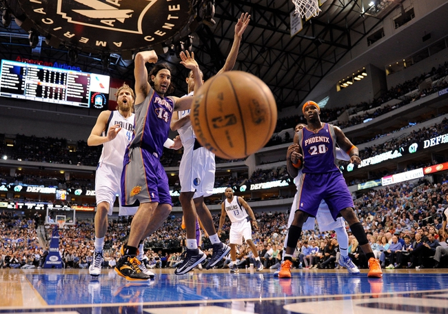 Apr 10, 2013; Dallas, TX, USA; Phoenix Suns power forward Luis Scola (14) and and center Jermaine O'Neal (20) and Dallas Mavericks power forward Dirk Nowitzki (41) and center Brandan Wright (34) watch as the ball is knocked out of bounds during the second half at the American Airlines Center. The Suns defeated the Mavericks 102-91. Mandatory Credit: Jerome Miron-USA TODAY Sports