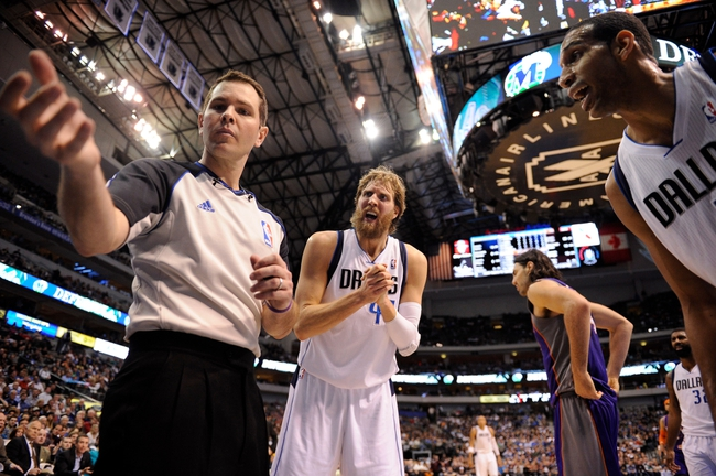 Apr 10, 2013; Dallas, TX, USA; Dallas Mavericks power forward Dirk Nowitzki (41) and center Brandan Wright (34) argue the out of bounds call by referee Brian Forte (45) during the second half against the Phoenix Suns at the American Airlines Center. The Suns defeated the Mavericks 102-91. Mandatory Credit: Jerome Miron-USA TODAY Sports