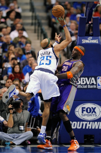 Apr 10, 2013; Dallas, TX, USA; Dallas Mavericks shooting guard Vince Carter (25) charges into Phoenix Suns center Jermaine O'Neal (20) during the second half at the American Airlines Center. The Suns defeated the Mavericks 102-91. Mandatory Credit: Jerome Miron-USA TODAY Sports