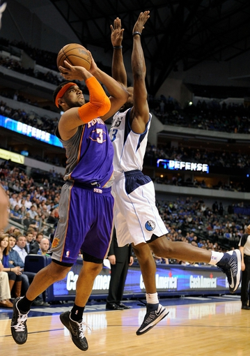 Apr 10, 2013; Dallas, TX, USA; Dallas Mavericks point guard Mike James (13) fouls Phoenix Suns shooting guard Jared Dudley (3) during the second half at the American Airlines Center. The Suns defeated the Mavericks 102-91. Mandatory Credit: Jerome Miron-USA TODAY Sports
