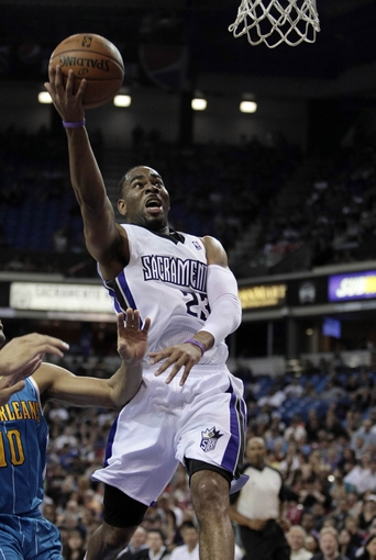 April 10, 2013; Sacramento, CA, USA; Sacramento Kings shooting guard Marcus Thornton (23) goes up for the basket after a fast break against the New Orleans Hornets during the second quarter at Sleep Train Arena. Mandatory Credit: Kelley L Cox-USA TODAY Sports