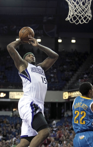 April 10, 2013; Sacramento, CA, USA; Sacramento Kings center DeMarcus Cousins (15) goes up to the basket against New Orleans Hornets point guard Brian Roberts (22) during the second quarter at Sleep Train Arena. Mandatory Credit: Kelley L Cox-USA TODAY Sports