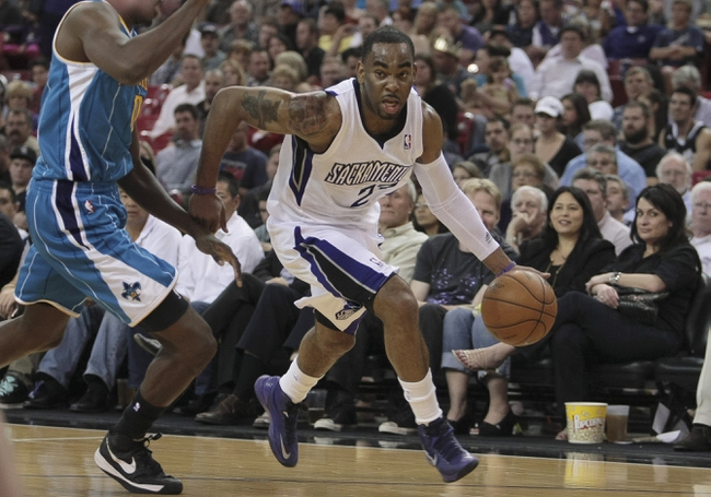 April 10, 2013; Sacramento, CA, USA; Sacramento Kings shooting guard Marcus Thornton (23) drives in against New Orleans Hornets small forward Al-Farouq Aminu (0) during the second quarter at Sleep Train Arena. Mandatory Credit: Kelley L Cox-USA TODAY Sports