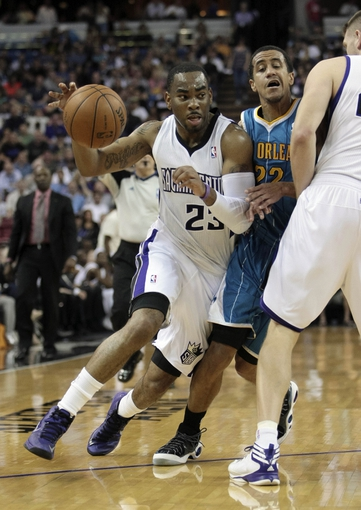 April 10, 2013; Sacramento, CA, USA; Sacramento Kings shooting guard Marcus Thornton (23) drives in against New Orleans Hornets point guard Brian Roberts (22) with a screen by Sacramento Kings center Cole Aldrich (45) during the second quarter at Sleep Train Arena. Mandatory Credit: Kelley L Cox-USA TODAY Sports