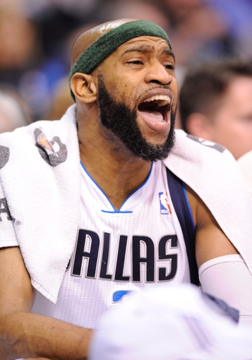 Apr 10, 2013; Dallas, TX, USA; Dallas Mavericks shooting guard Vince Carter (25) yells to his teammates from the bench during the second half against the Phoenix Suns at the American Airlines Center. The Suns defeated the Mavericks 102-91. Mandatory Credit: Jerome Miron-USA TODAY Sports
