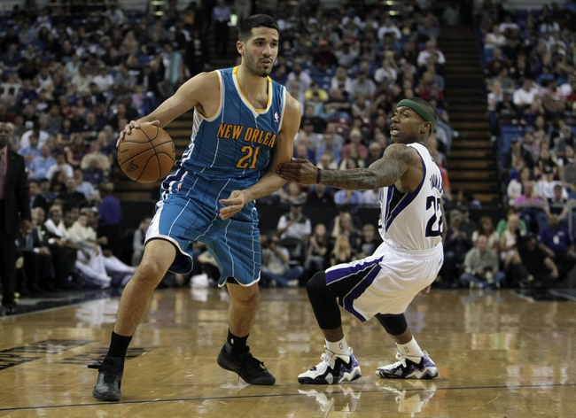April 10, 2013; Sacramento, CA, USA; New Orleans Hornets point guard Greivis Vasquez (21) dribbles the ball against Sacramento Kings point guard Isaiah Thomas (22) during the third quarter at Sleep Train Arena. The Sacramento Kings defeated the New Orleans Hornets 121-110. Mandatory Credit: Kelley L Cox-USA TODAY Sports