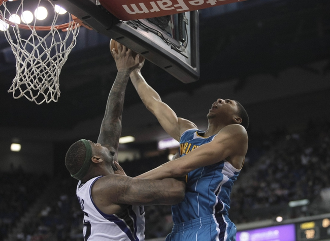 April 10, 2013; Sacramento, CA, USA; Sacramento Kings center DeMarcus Cousins (15) blocks the shot by New Orleans Hornets power forward Anthony Davis (23) during the third quarter at Sleep Train Arena. The Sacramento Kings defeated the New Orleans Hornets 121-110. Mandatory Credit: Kelley L Cox-USA TODAY Sports