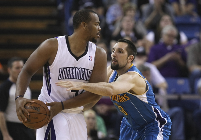 April 10, 2013; Sacramento, CA, USA; New Orleans Hornets power forward Ryan Anderson (33) reaches in against Sacramento Kings power forward Chuck Hayes (42) during the third quarter at Sleep Train Arena. The Sacramento Kings defeated the New Orleans Hornets 121-110. Mandatory Credit: Kelley L Cox-USA TODAY Sports