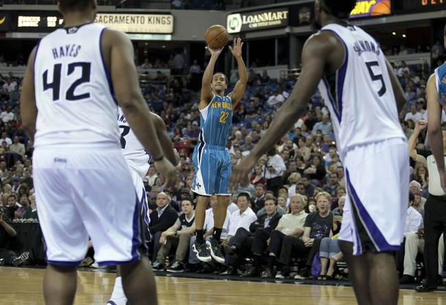 April 10, 2013; Sacramento, CA, USA; New Orleans Hornets point guard Brian Roberts (22) makes a three point basket against the Sacramento Kings during the third quarter at Sleep Train Arena. The Sacramento Kings defeated the New Orleans Hornets 121-110. Mandatory Credit: Kelley L Cox-USA TODAY Sports