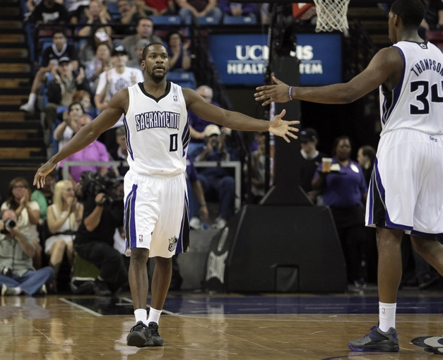 April 10, 2013; Sacramento, CA, USA; Sacramento Kings point guard Toney Douglas (0) high fives power forward Jason Thompson (34) after the basket against the New Orleans Hornets during the fourth quarter at Sleep Train Arena. The Sacramento Kings defeated the New Orleans Hornets 121-110. Mandatory Credit: Kelley L Cox-USA TODAY Sports