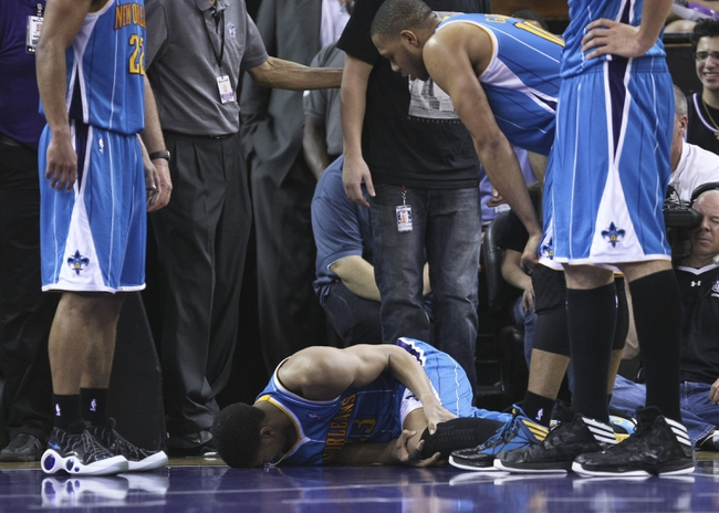 April 10, 2013; Sacramento, CA, USA; New Orleans Hornets power forward Anthony Davis (23) holds his left knee after spraining it drawing an offensive foul against the Sacramento Kings during the fourth quarter at Sleep Train Arena. The Sacramento Kings defeated the New Orleans Hornets 121-110. Mandatory Credit: Kelley L Cox-USA TODAY Sports