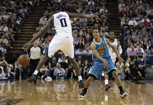 April 10, 2013; Sacramento, CA, USA; Sacramento Kings point guard Toney Douglas (0) kicks the intended pass by New Orleans Hornets point guard Brian Roberts (22) during the fourth quarter at Sleep Train Arena. The Sacramento Kings defeated the New Orleans Hornets 121-110. Mandatory Credit: Kelley L Cox-USA TODAY Sports