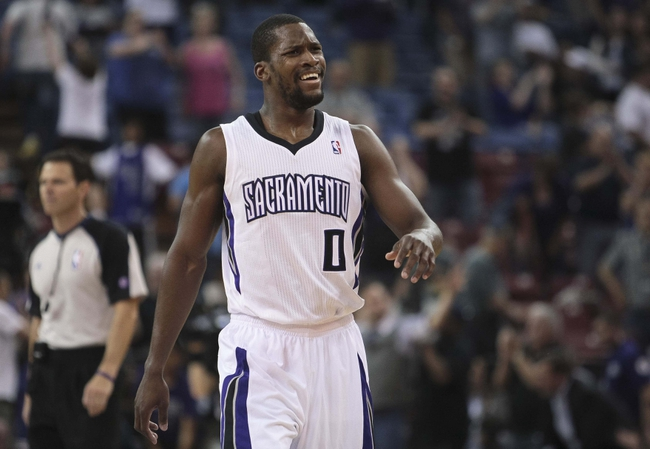 April 10, 2013; Sacramento, CA, USA; Sacramento Kings point guard Toney Douglas (0) reacts at the end of the game against the New Orleans Hornets at Sleep Train Arena. The Sacramento Kings defeated the New Orleans Hornets 121-110. Mandatory Credit: Kelley L Cox-USA TODAY Sports