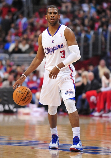 April 10, 2013; Los Angeles, CA, USA; Los Angeles Clippers point guard Chris Paul (3) controls the ball against the Minnesota Timberwolves during the second half at Staples Center. Mandatory Credit: Gary A. Vasquez-USA TODAY Sports